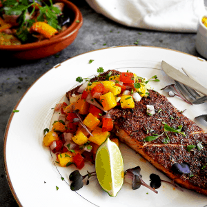 Baked Cajun Salmon on a plate with salsa