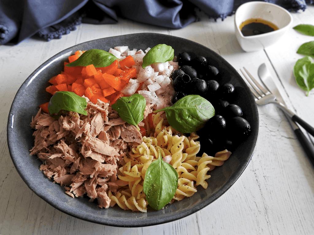 Healthy Tuna Pasta Salad prepared ingredients in a bowl