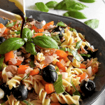 Healthy Tuna Pasta Salad Recipe with dressing being drizzled over