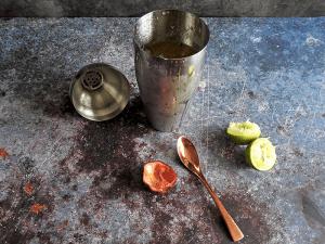 Preparing Porn Star Martini in a cocktail shaker