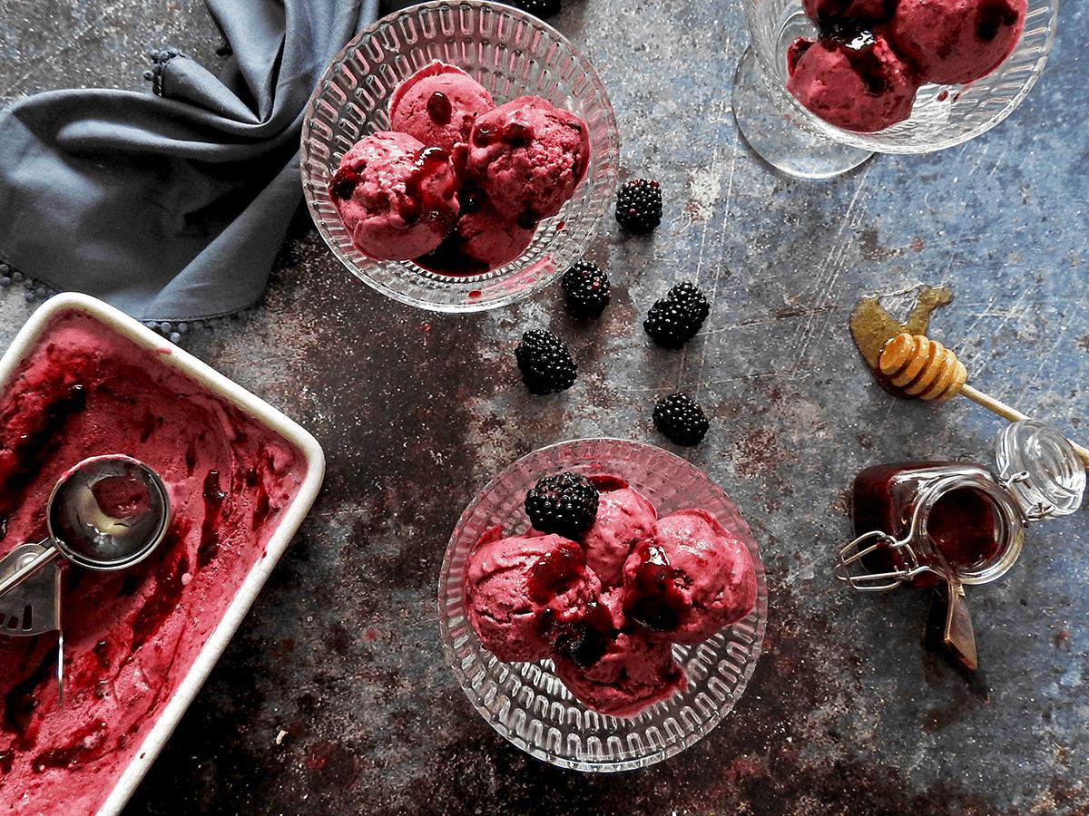 Overhead picture of 3 bowls of blackberry frozen yogurt