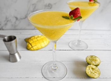 Mango daiquiris in martini glasses on a counter