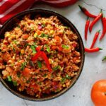 Easy Mexican Rice overhead with chillis scattered around