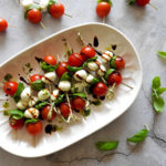 Caprese skewers from overhead on a plate
