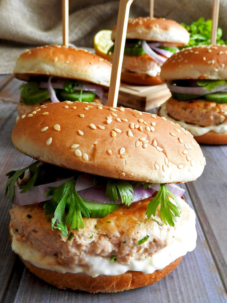 Salmon burgers on a table