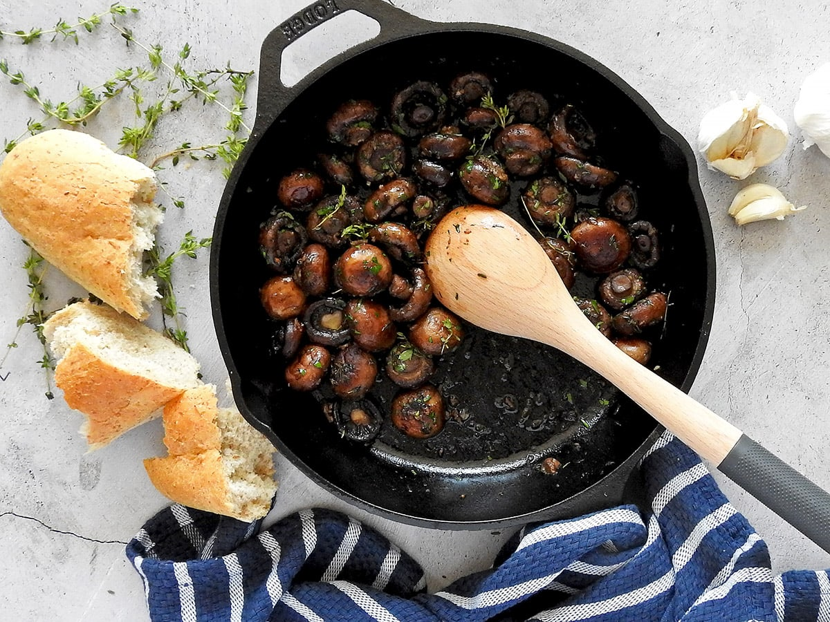 Garlic Mushrooms in a pan with some bread
