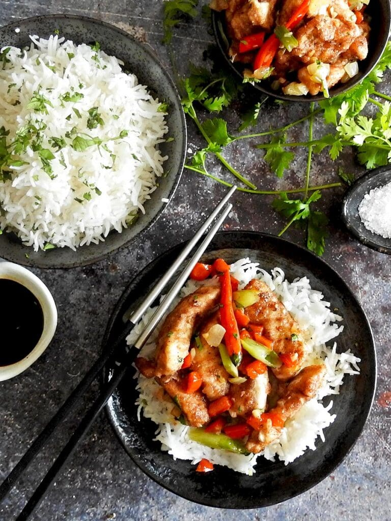 Salt and pepper chicken with rice in a bowl