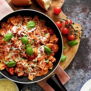 Chicken and Chorizo pasta in a pan on a wooden board