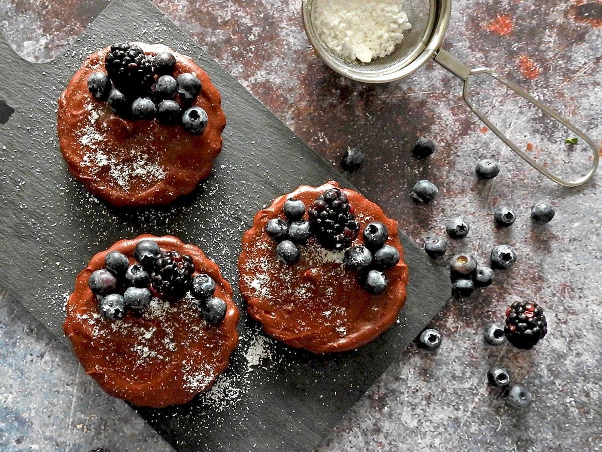 Mini Chocolate Tarts with icing sugar and berries