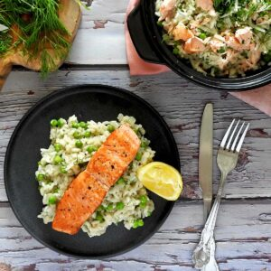 Salmon risotto on a plate with cutlery