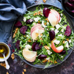 Beetroot and goat's cheese salad on a plate with dressing