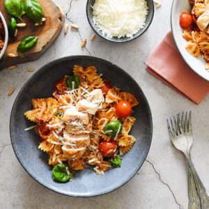 Red Pesto Pasta in bowls on a counter