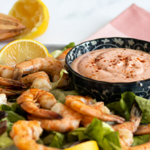 Marie Rose sauce on a plate of prawns and lemon