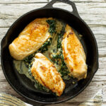 Spinach Stuffed Chicken in a pan