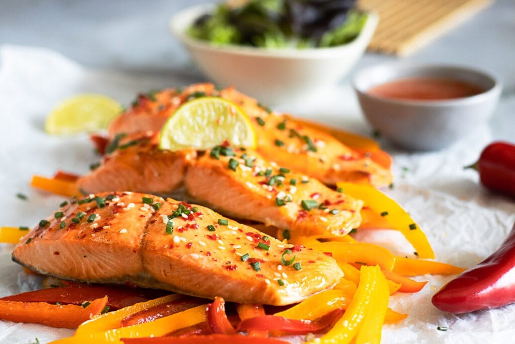 Sweet Chilli Salmon with Salad in the backround