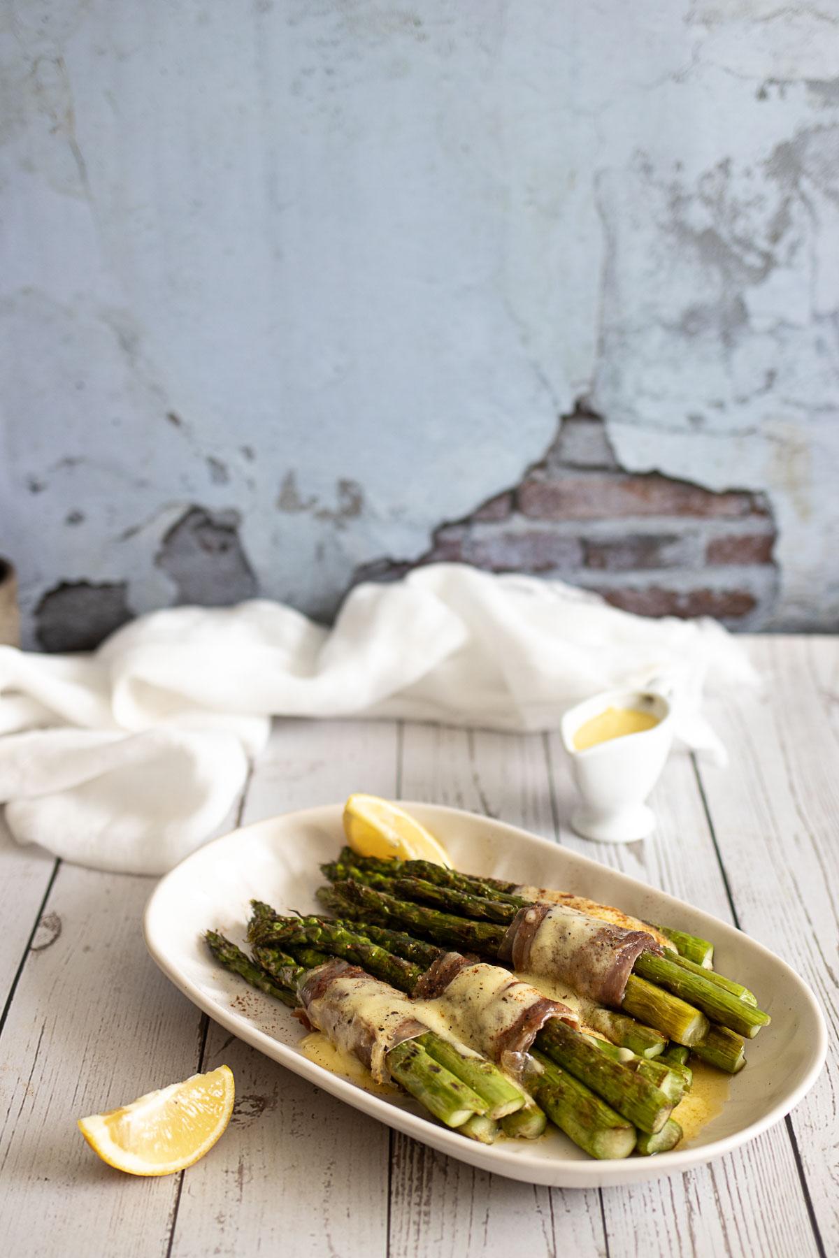 Asparagus and Parma ham on a table