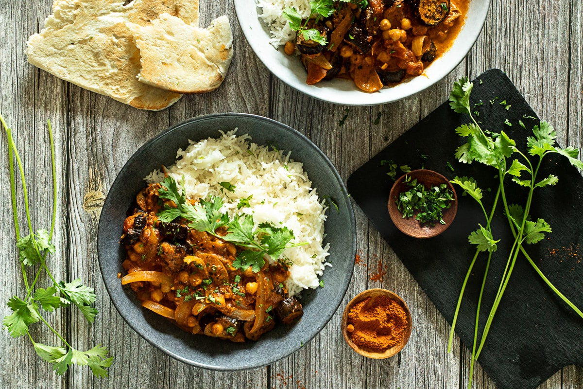 Aubergine curry with naan and fresh coriander