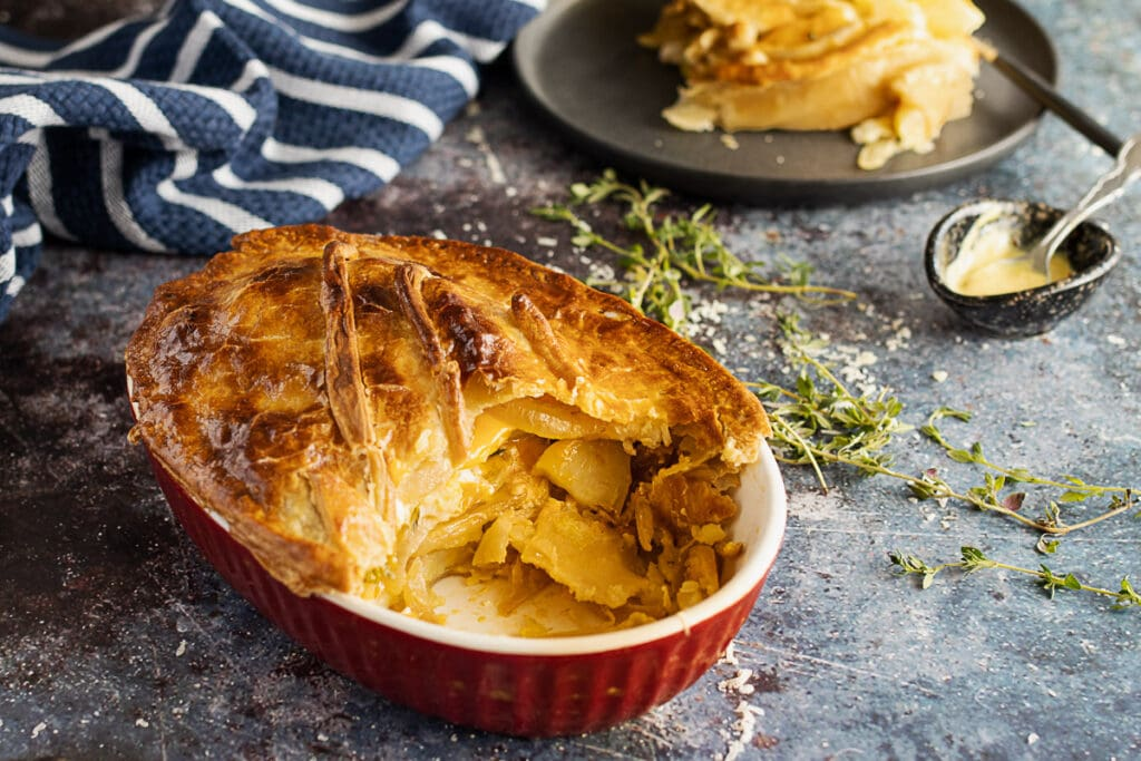 Cheese and potato pie with a portion removed