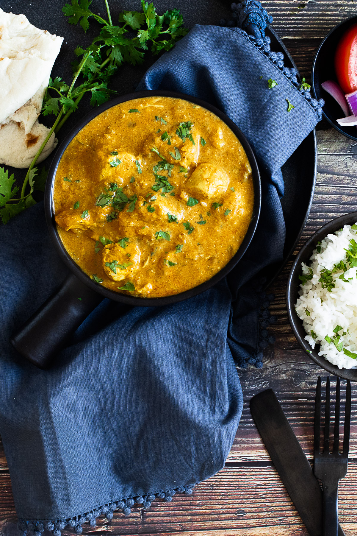 Slow cooker chicken korma on a napkin with rice