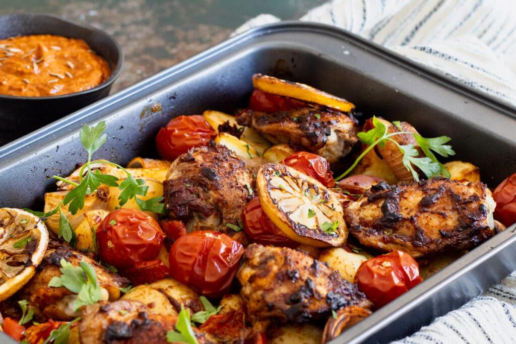 Harissa Chicken with a bowl of harissa sauce