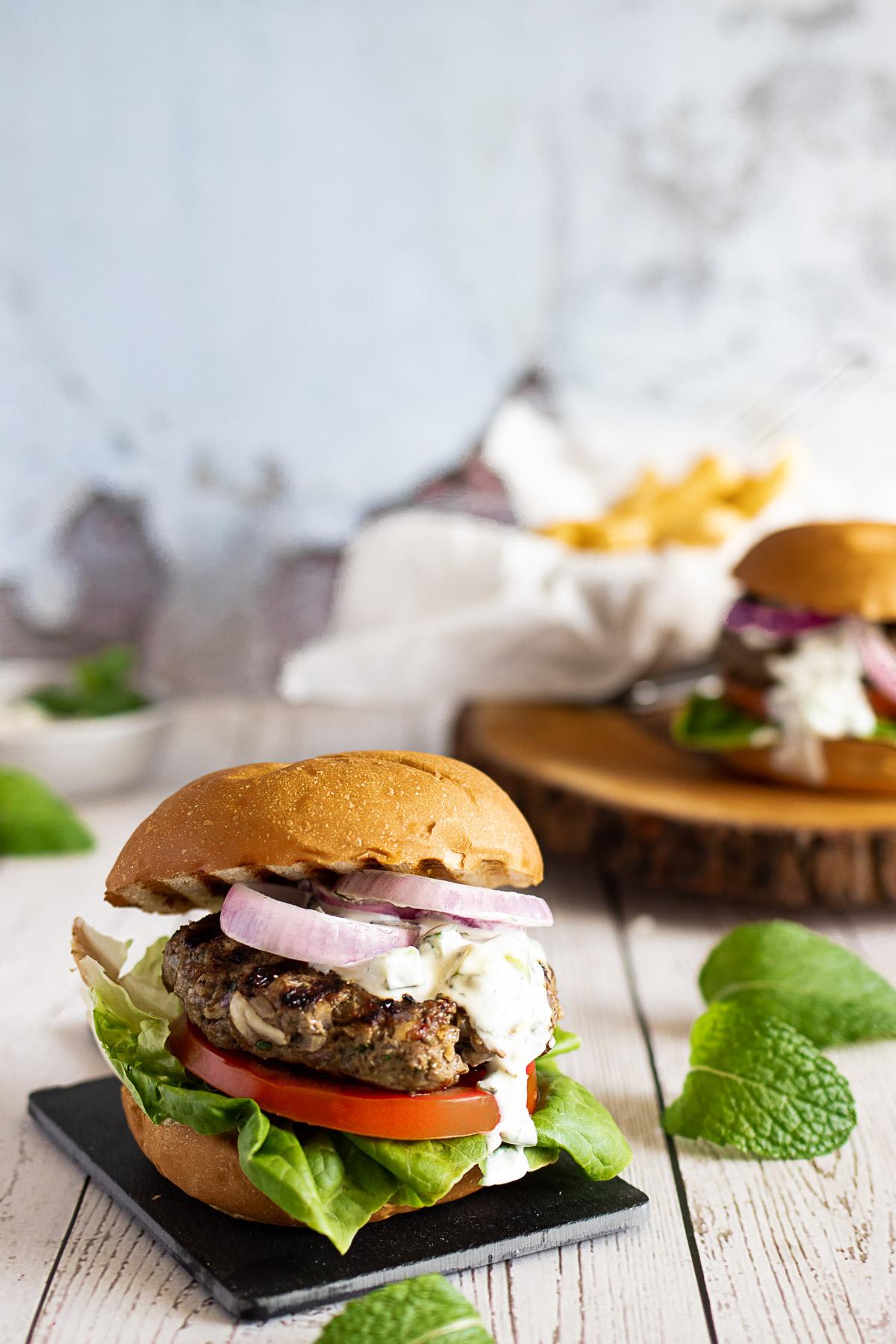 Mint lamb burger on a slate