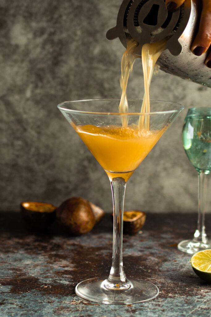 Pornstar Martini Being Poured into a Glass