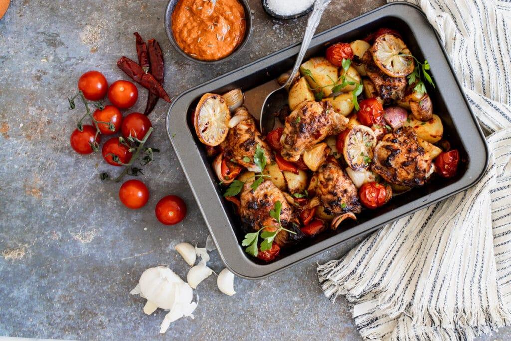 Harissa chicken with tomatoes and chilis around