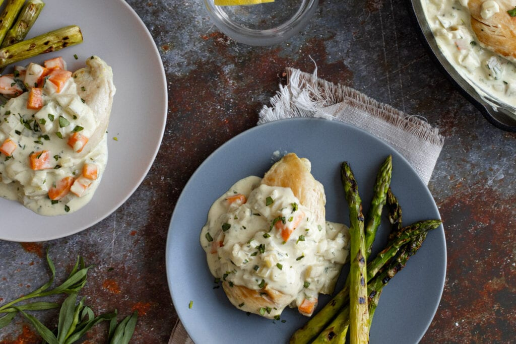 Tarragon Chicken on a plate with asparagus