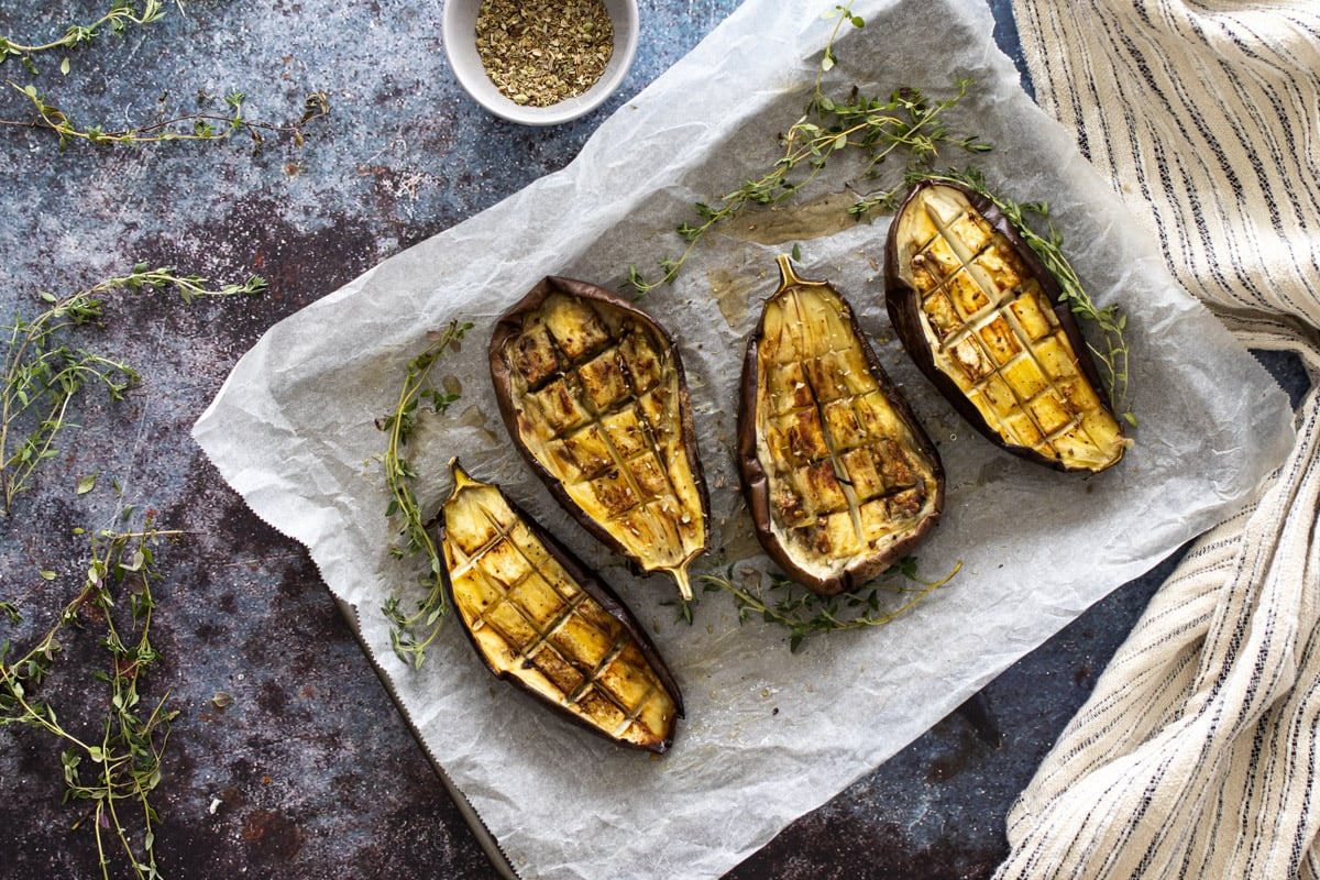Roasted Aubergines on a baking tray with thyme