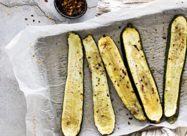 Roasted courgette on a baking tray