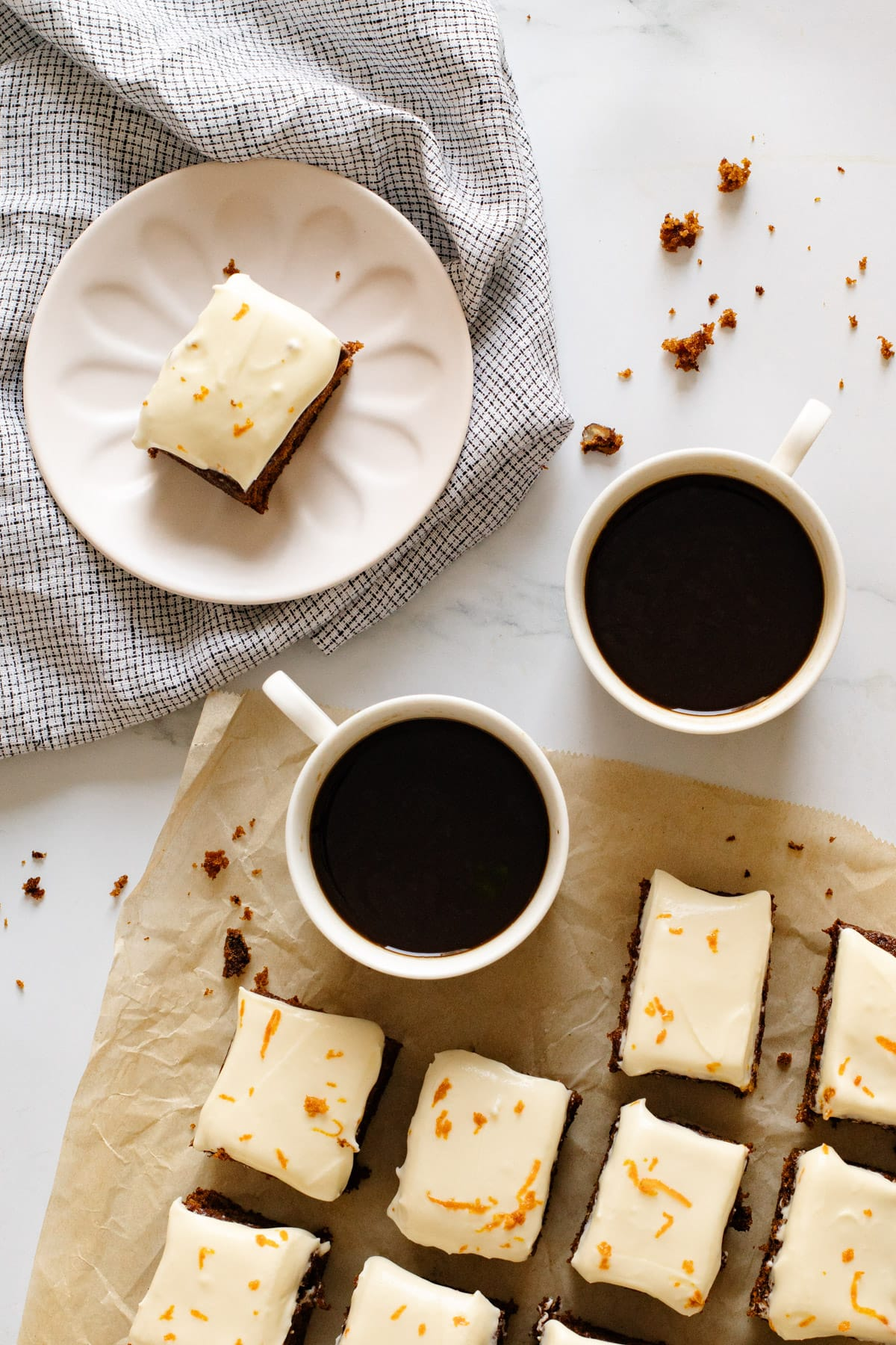 Carrot cake traybake on a plate with coffee cups