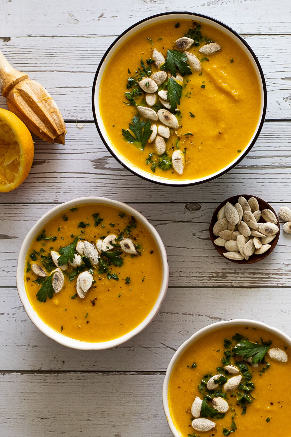 3 bowls of carrot and orange soup