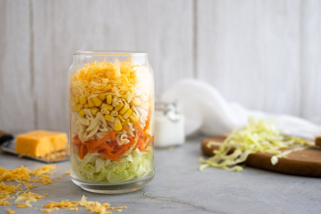 Cheese salad layered in a jar
