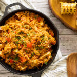 Chicken and chorizo jambalaya in a pan with a spoon