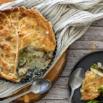 Chicken and mushroom pie spooned onto a plate