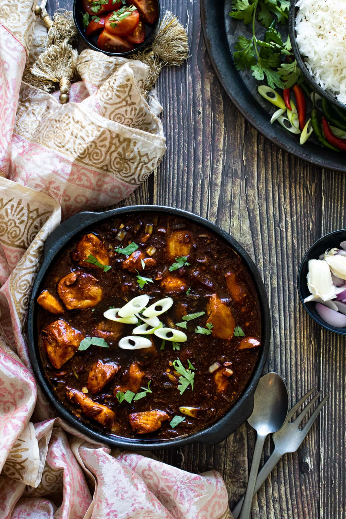 Chicken Manchurian on a table with patterned fabric