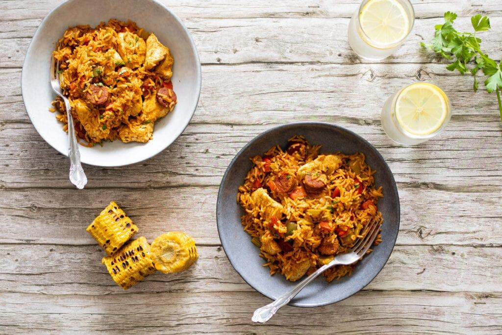 Chicken and chorizo jambalaya in bowls with corn