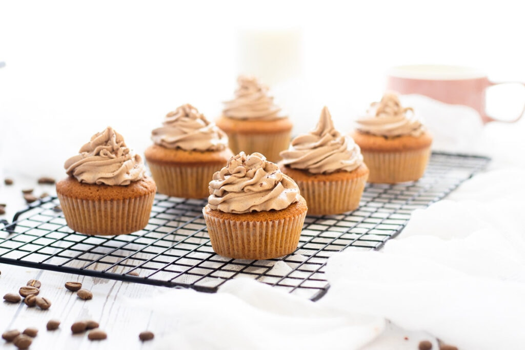 Coffee and walnut cupcakes on a wire rack