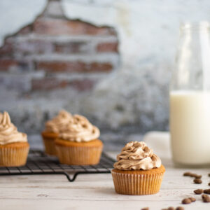 Coffee and walnut cupcakes with milk and coffee beans