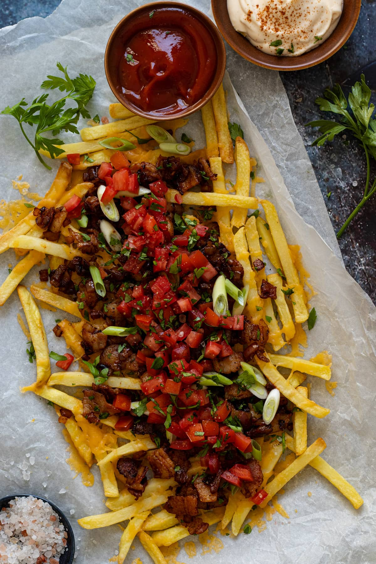 Dirty fries on paper with ketchup