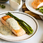 Salmon and asparagus with parsley sauce