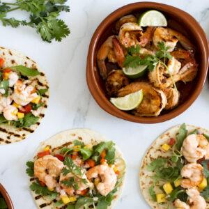 Prawn tacos with a bowl of prawns