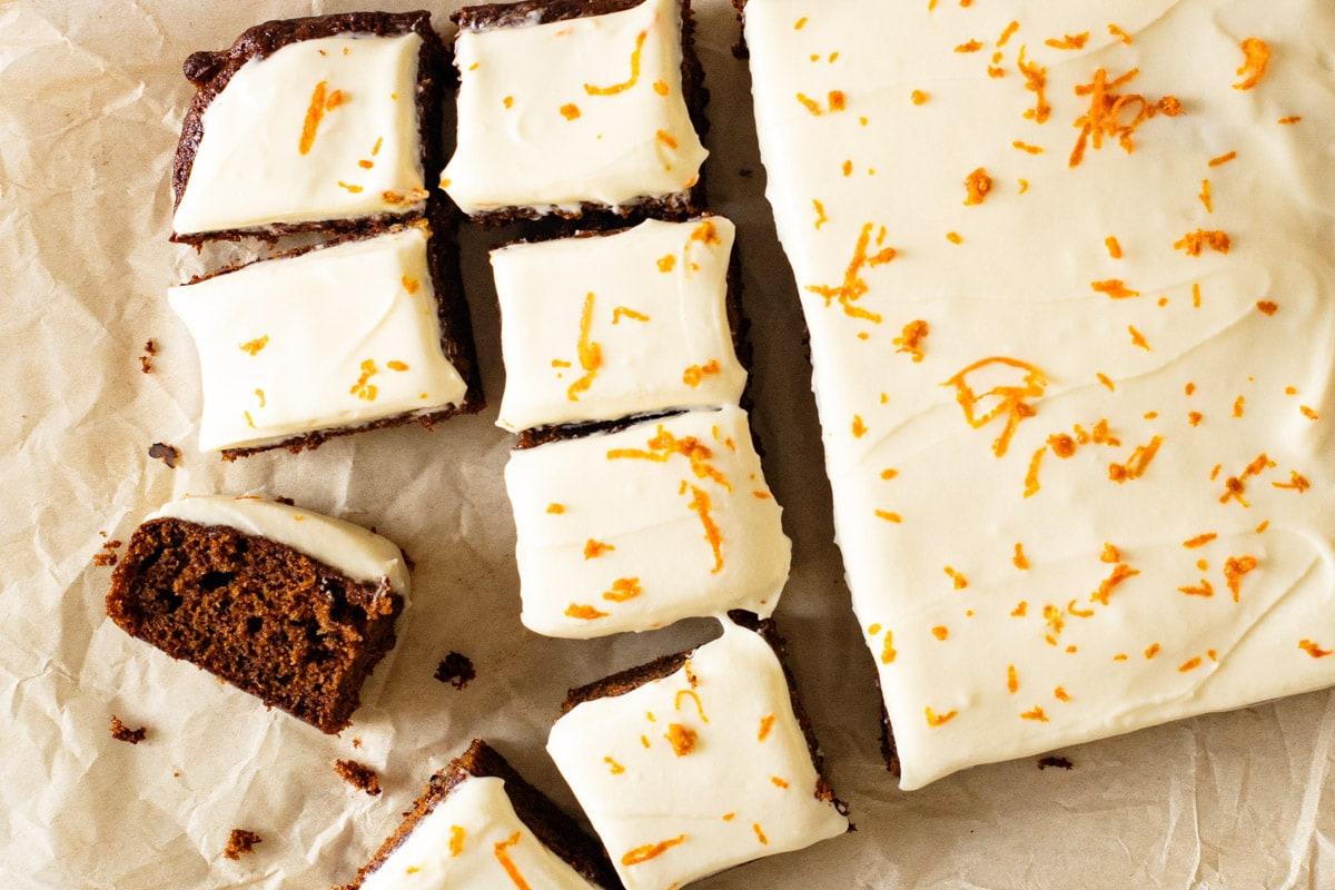Sliced carrot cake traybake on baking paper