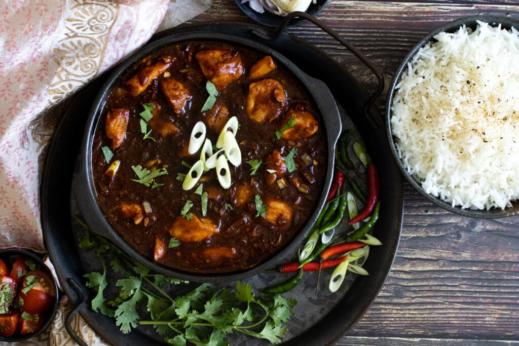 Chicken Manchurian in a bowl on a tray