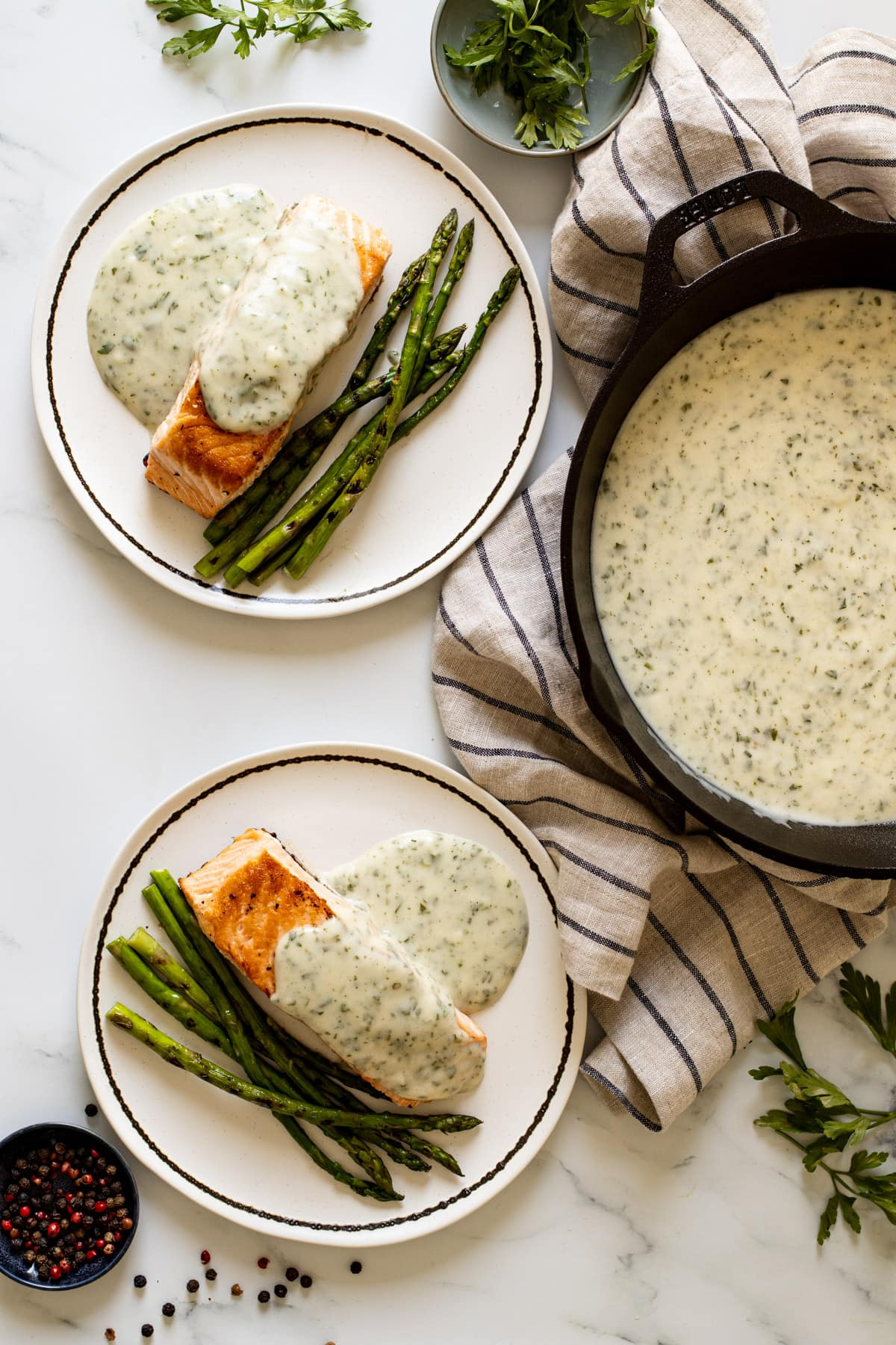 Parsley Sauce in a pan with salmon and asparagus on a plate