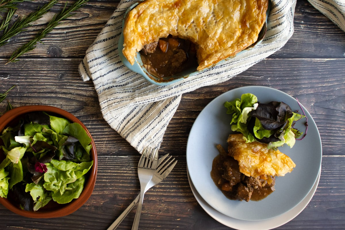 Slow cooker steak pie with a spoonful taken our