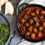 Spanish meatballs in a pan with parsley