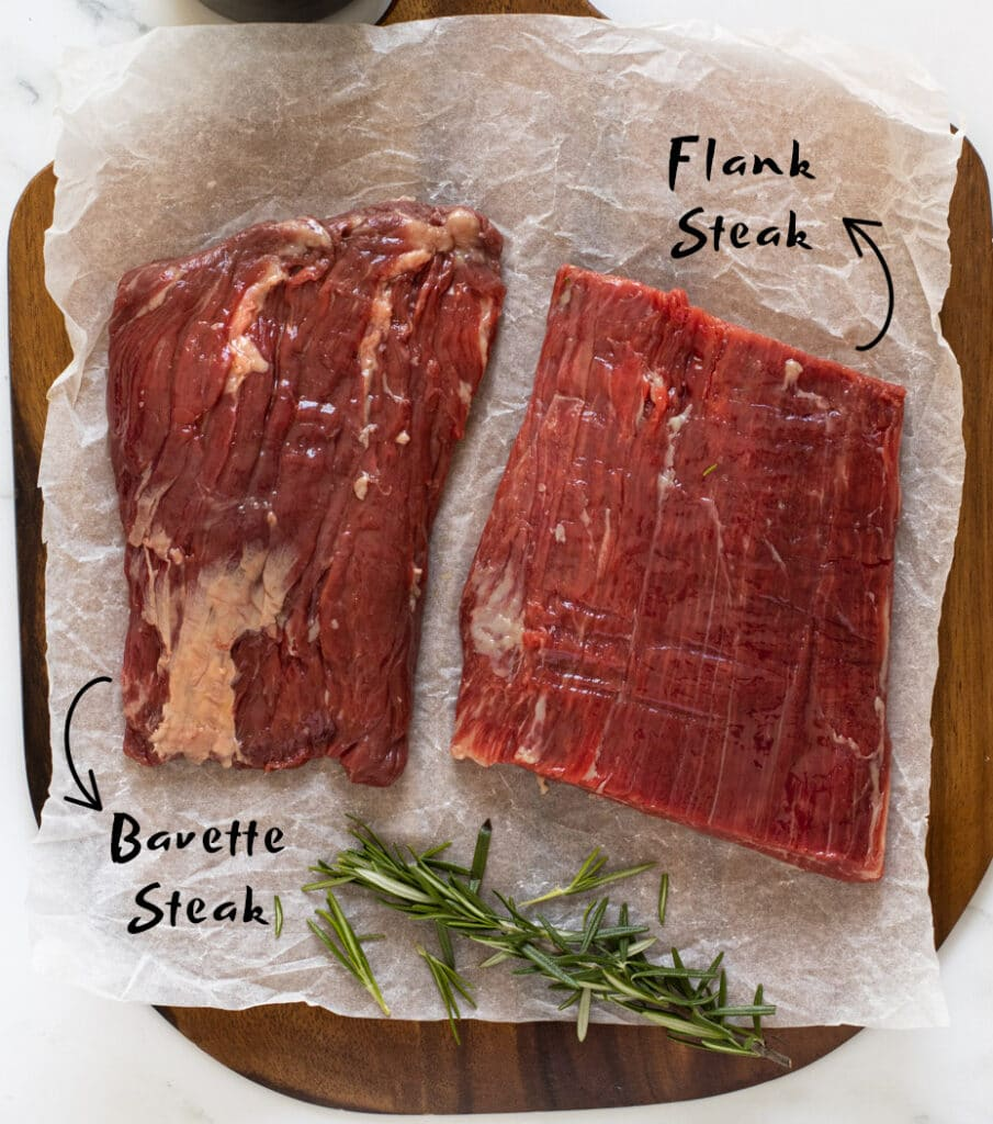 Bavette steak next to flank on a board
