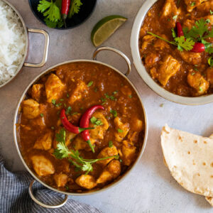 Chicken Pathia in a bowl with rice and chapati
