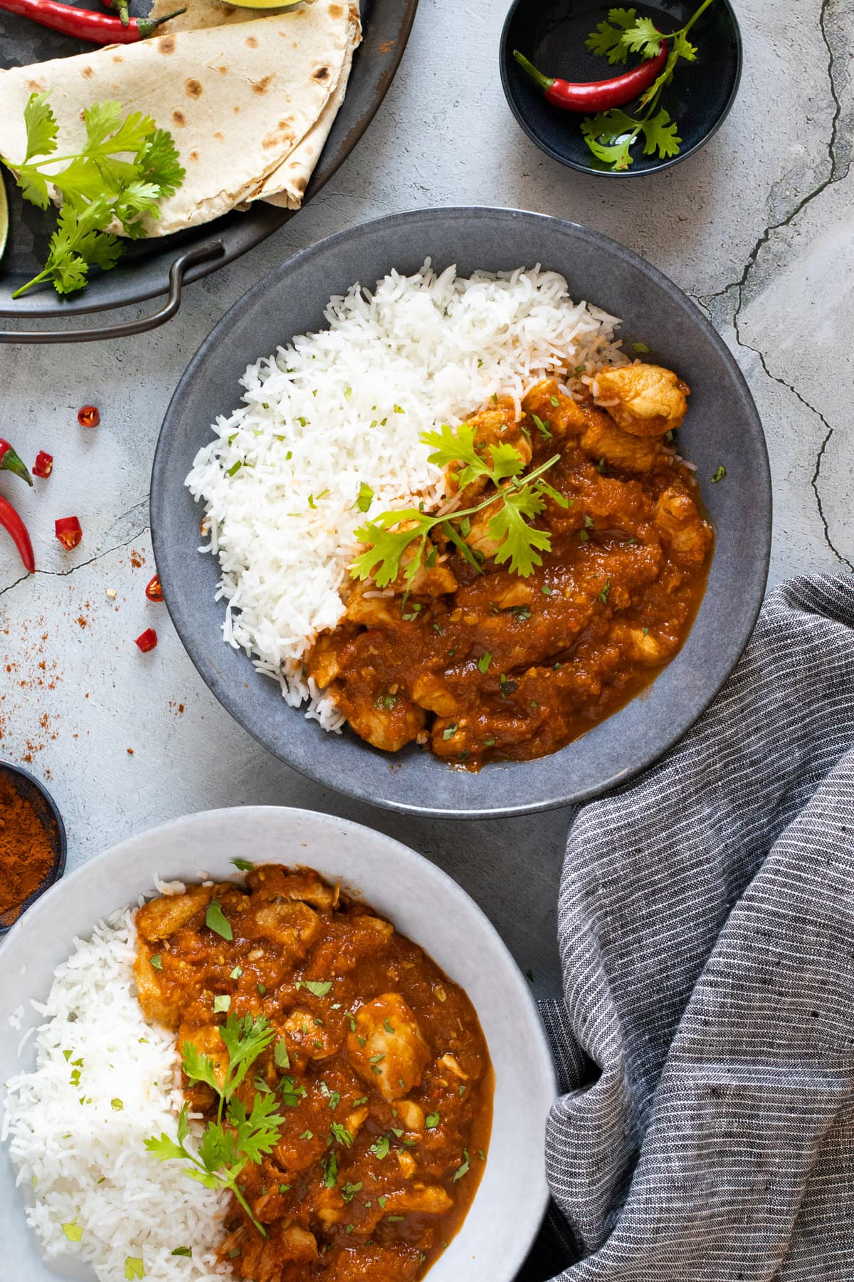 Chicken pathia in bowls with rice and coriander